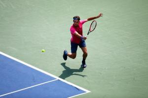 CINCINNATI, OH - AUGUST 23: Roger Federer of Switzerland returns a shot to Novak Djokovic of Serbia during the finals of the Western & Southern Open at the Linder Family Tennis Center on August 23, 2015 in Cincinnati, Ohio. (Photo by Rob Carr/Getty Images)